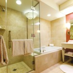 Light modern bath with cozy towel hooks at the glass