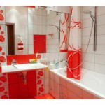 Small tiled bathroom in red ans white tones with mirror