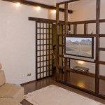 Wooden shelves in living room for home appliances