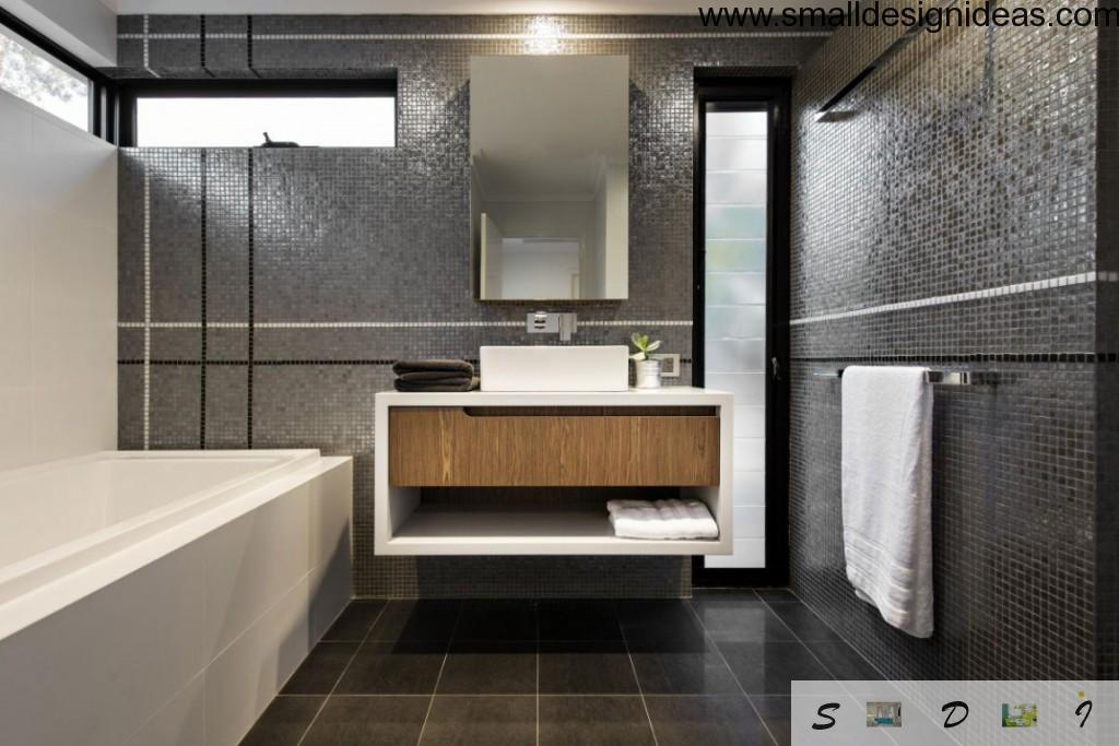 Dark mosaic in hi-tech bath interior