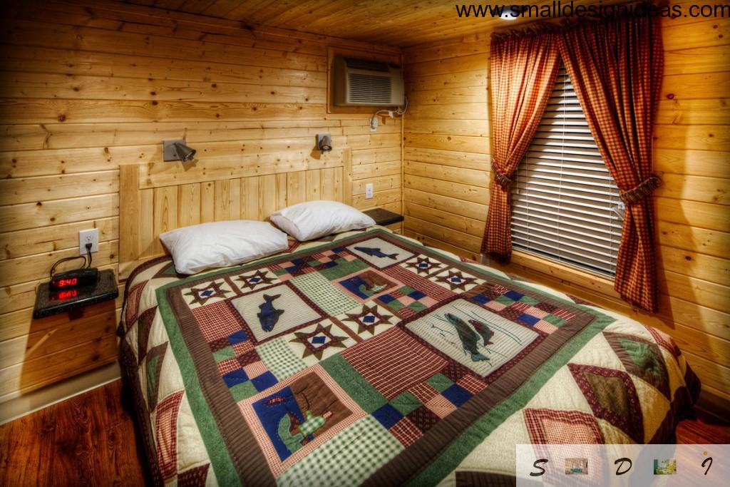 Rustic wooden house bedroom in light wood colors
