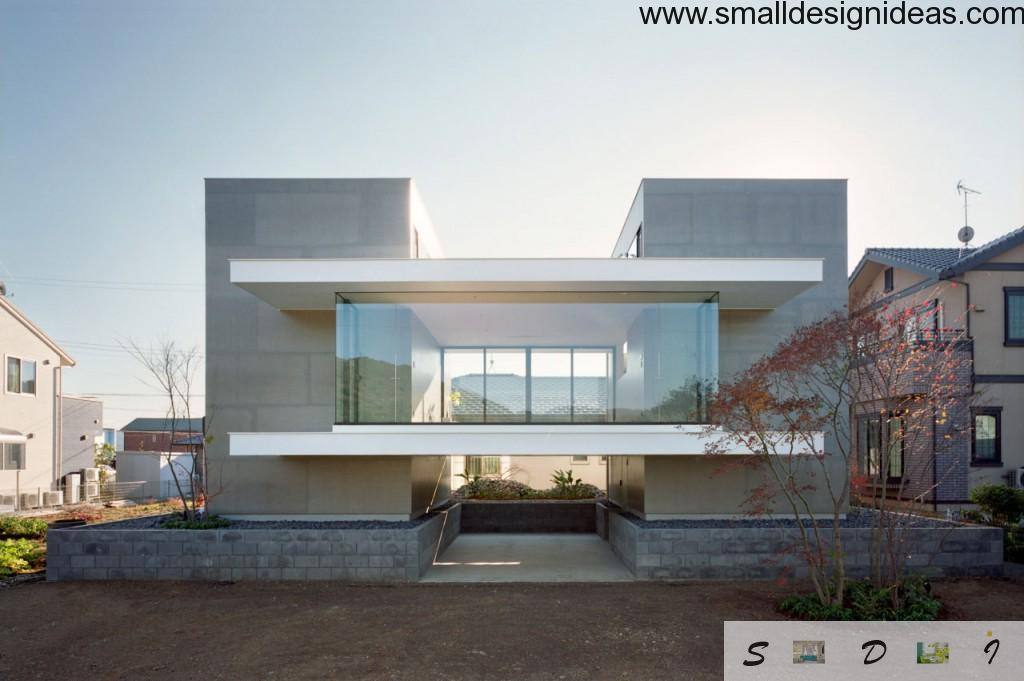 Unique stunning house facade in minimalistic style with a lot of glass