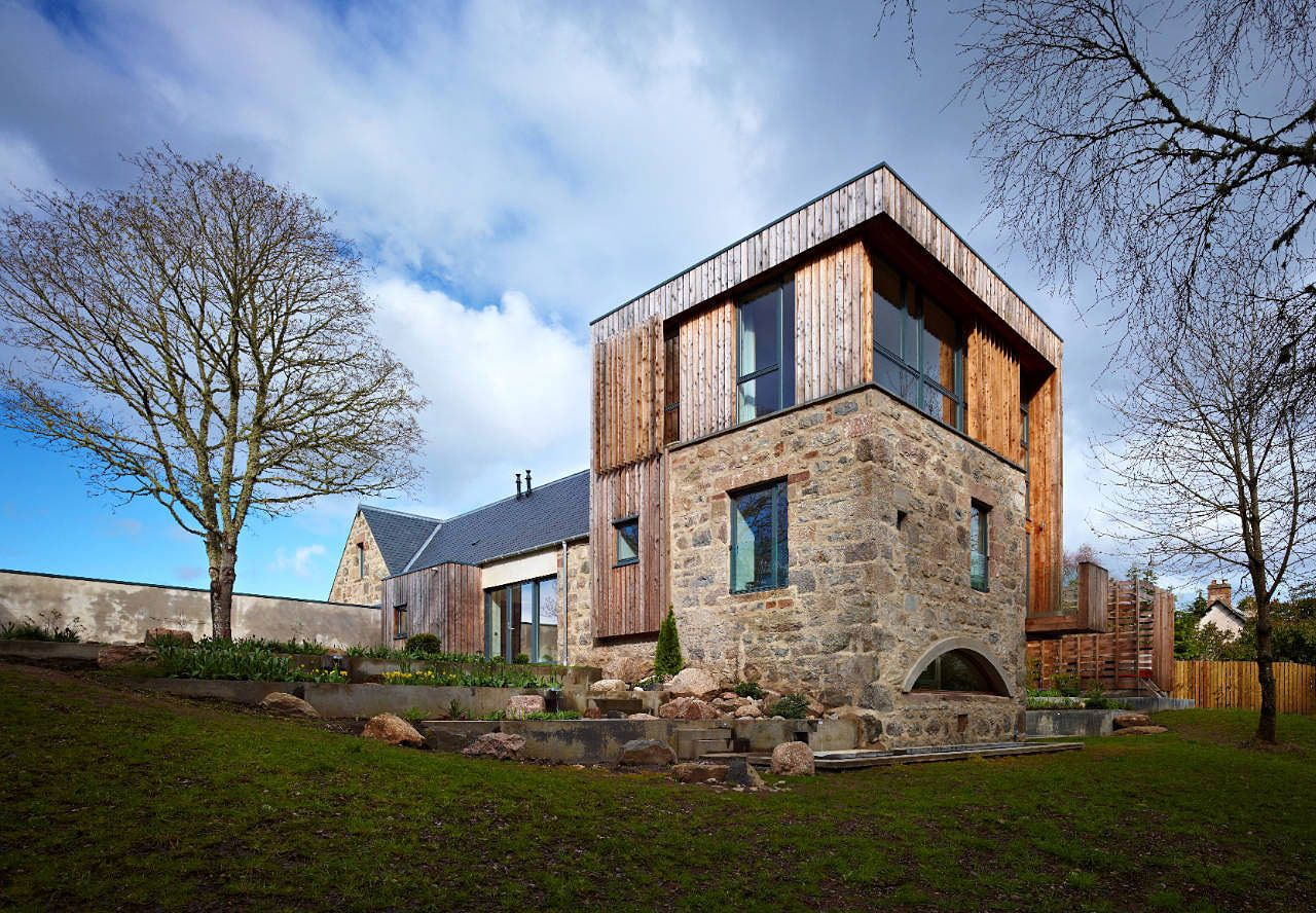 Scottish country house design style of wood and stone facade
