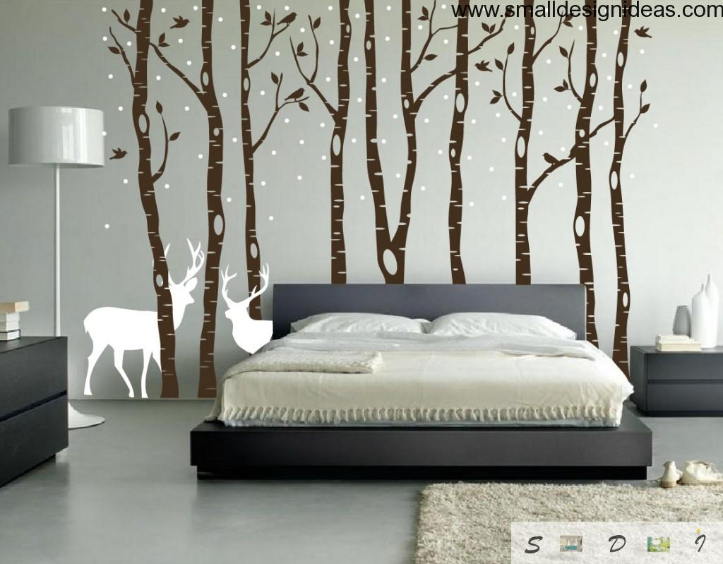 Country-side bedroom in light tones with deers and birch-trees