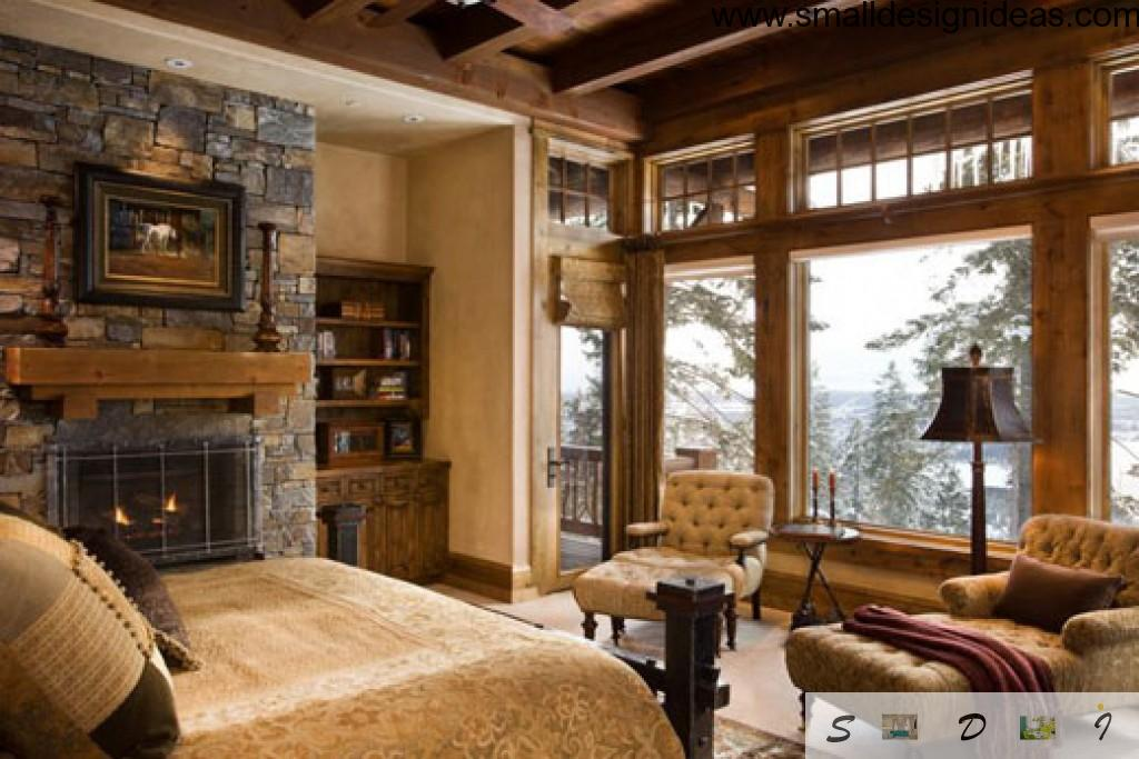 Wooden bedroom interior with stone fireplace