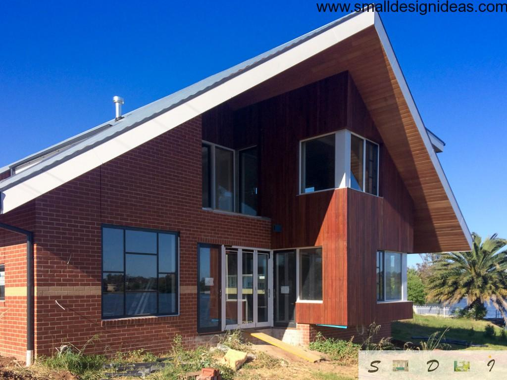 German style angle roof and red bricks facade design of the house