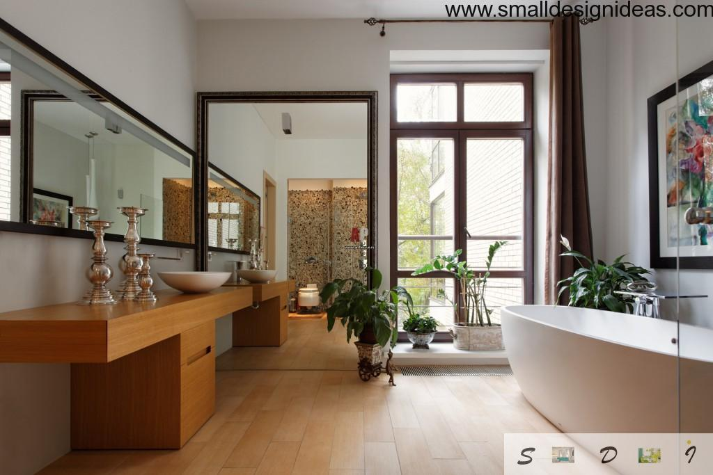 Bathroom in a house with hige mirror and restrained color palette of interior
