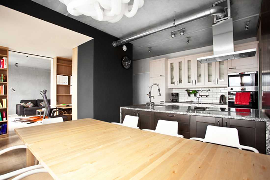 Two level apartment in loft style for Small loft kitchen designs