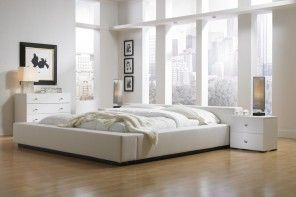 Nice wide-window spacious white bedroom with contrasting elements