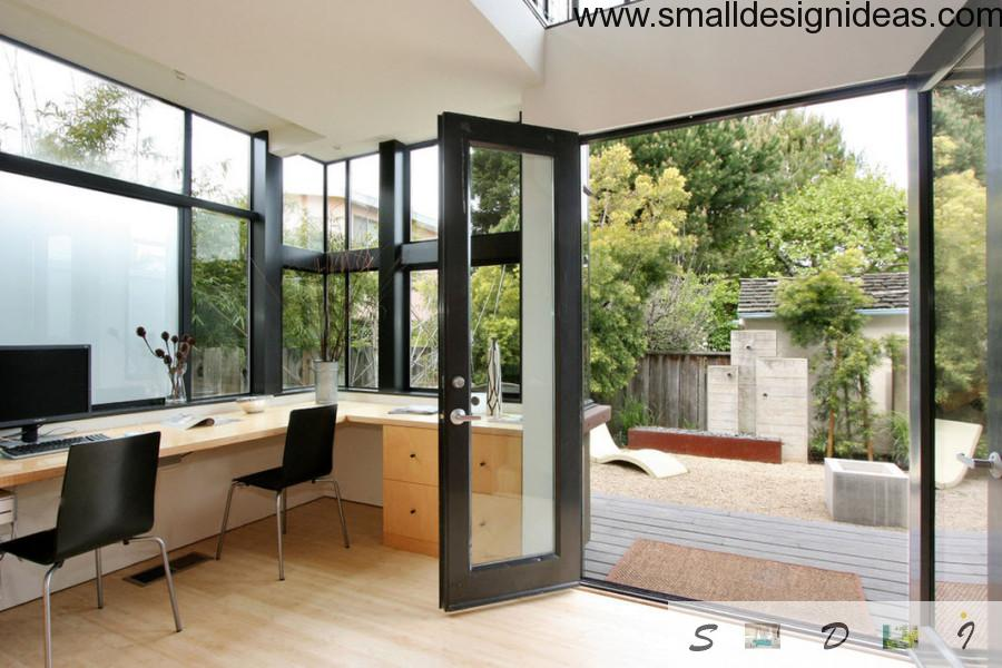 Spacious village house study room with a lot of natural light and materials