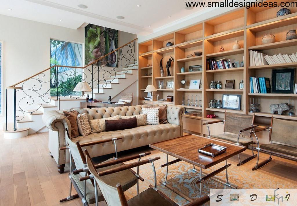 Airy forged black elegant staircase in the design of countryside living room with light wooden open shelves