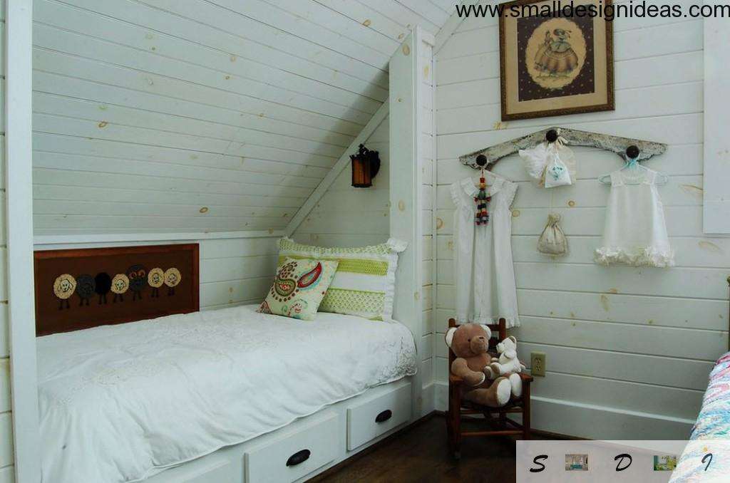 Attic room with with bed with drawers