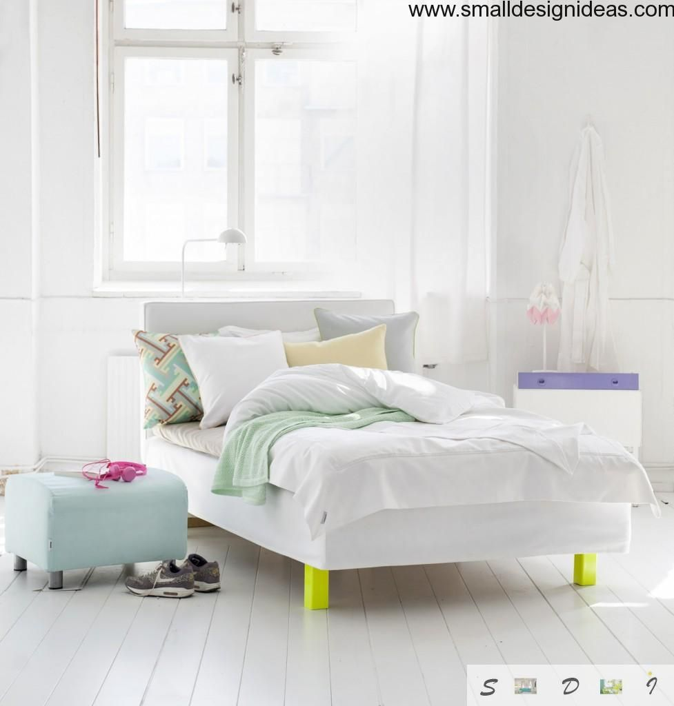 Unusual wooden furniture and bright textile in the bedroom - is the specific feature of the Scandinavian style