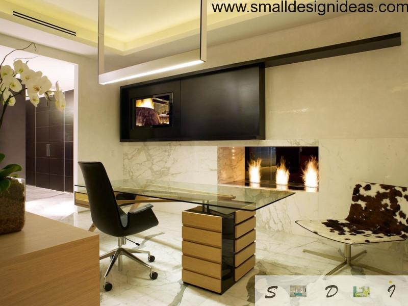 Modern home office with glass table and artificial fireplace
