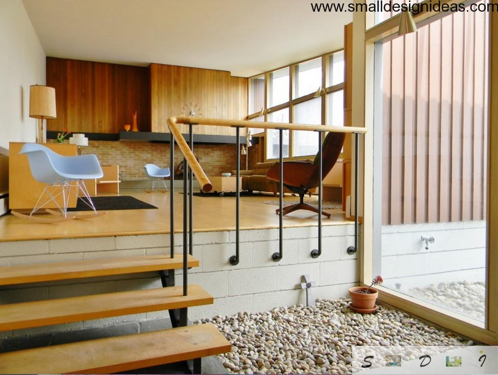 semi-floor stairs in the wooden bright interior of the living