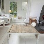Unusual wooden table in the white tones, combined with plastic and metal furniture creates unique ambience of Scandinavian style in the interior