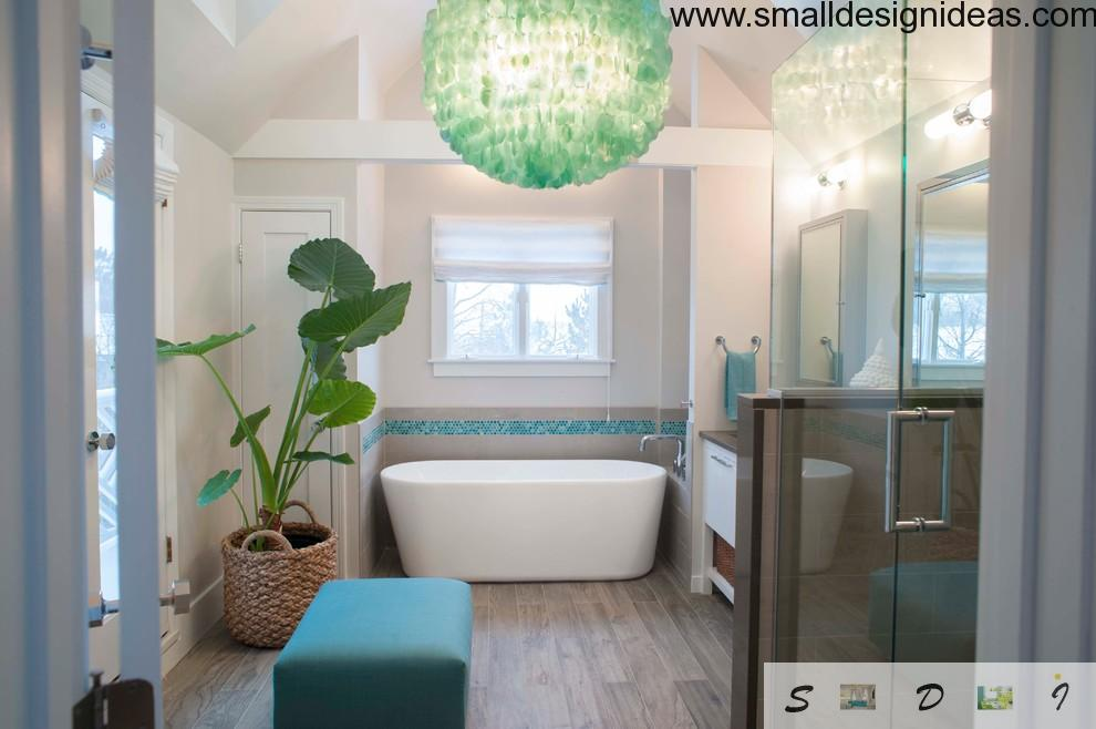 Green chandelier and a huge plant in the bathroom of the house
