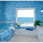 Fully thematic sea bathroom with mosaic tile in pleasant blue hues
