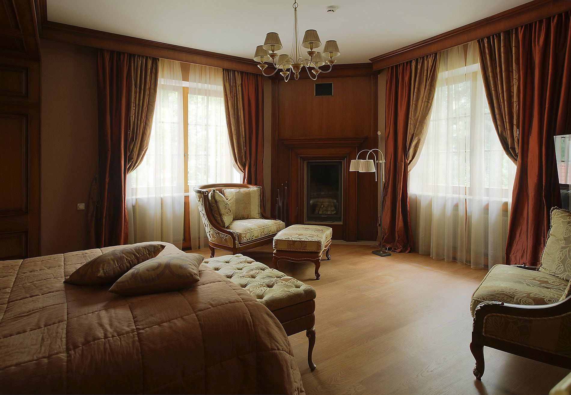 Red wood makes english style interior look stately