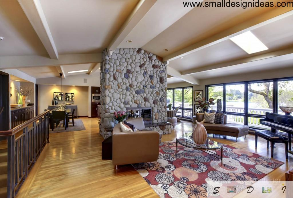 countryside house with ultramodern living room design and the stone trimmed fireplace