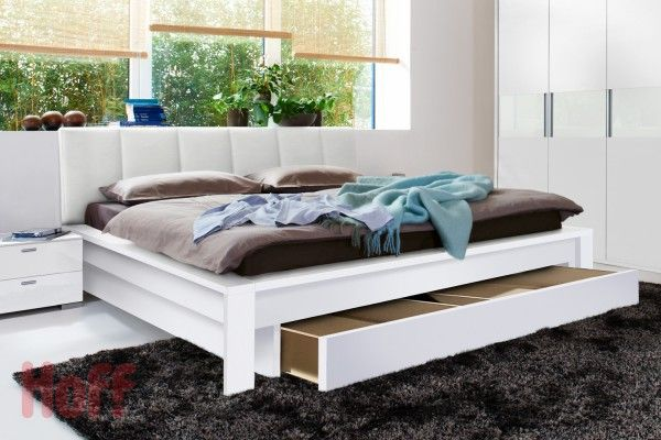 Bed with Drawers. Modern Design. Bedroom looks perfect with a lot of light and functional beds