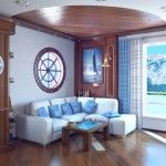 Small rest zone in the living room with porthole window, bell and picture