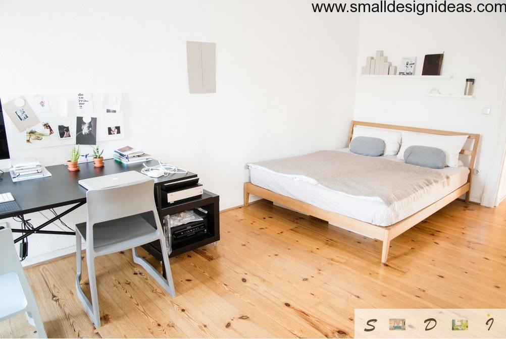 Bedroom separated to zones with light wooden floor in Scandinavian style