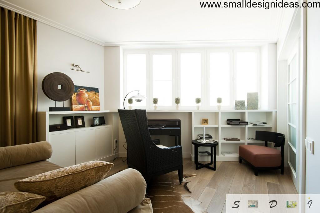 Study room in Modern style with natural lighting and black wicker armchair