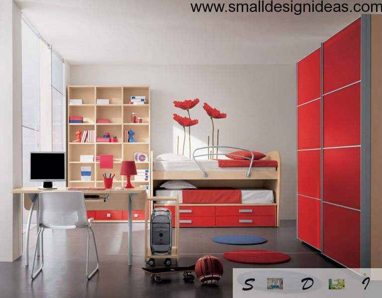 Example of the red design of the children room with bunk bed and storage drawers