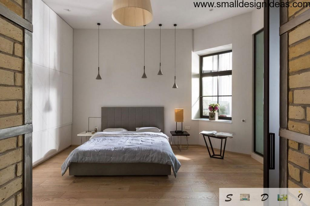 Wide window in the Loft bedroom located right next to the bed and pendant lights