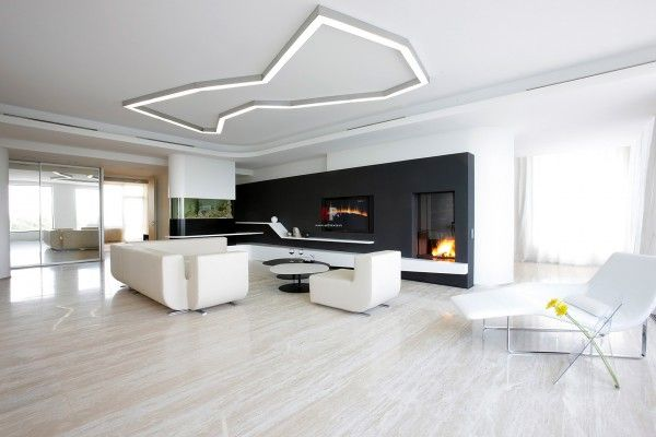 Minimalism Interior Design Style in the living room with fireplace, contrasting black wall and unusual lighting