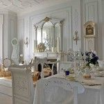 White interior of the English styled dining room with a big mirror