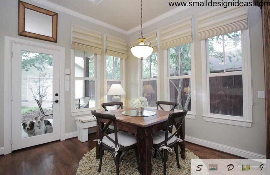 Wooden furniture in the wide windowed dining room
