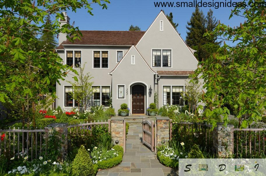 Gray trim of the house and verdure makes the English style of the house distinguishable