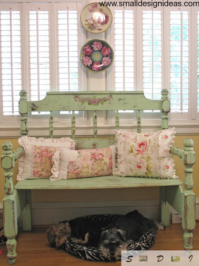 Aged bench with pink cushions and a pets under