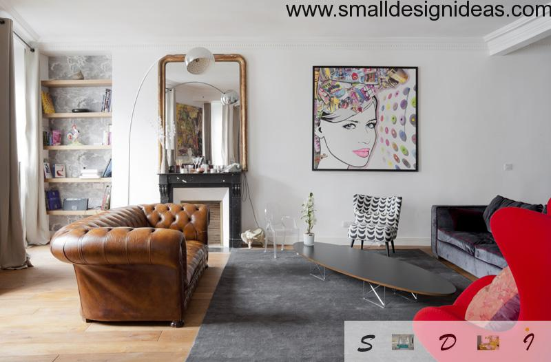 White interior of the living room with rug, leather armchair, picture and other small elements