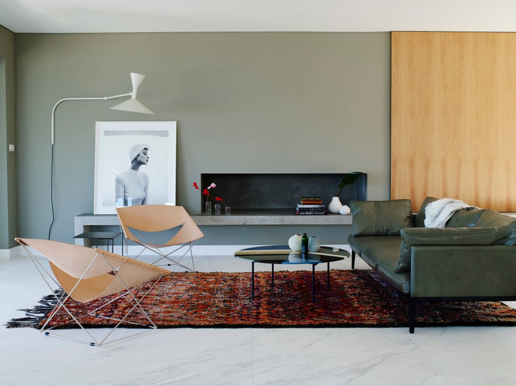 Minimalistic touch of the cozy furnished living room with rug and tiny chairs