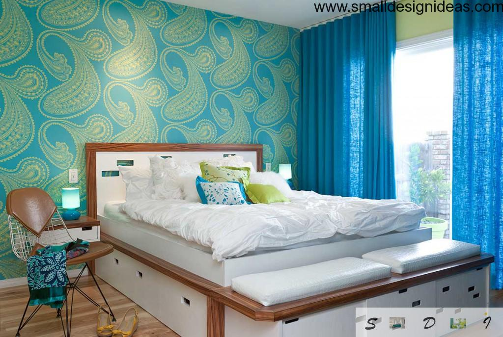Bright decor and painted wall in the interior of small bedroom