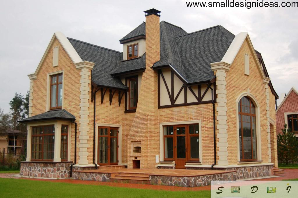 Cottage from sandy colored bricks and mahogany door and windows with an area for veranda at the entrance