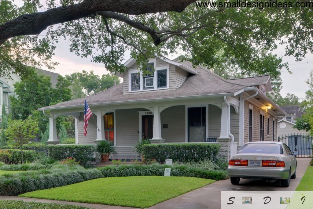 English style house with dark gray roof tile and grey panelled walls which is favourite for American townhouses