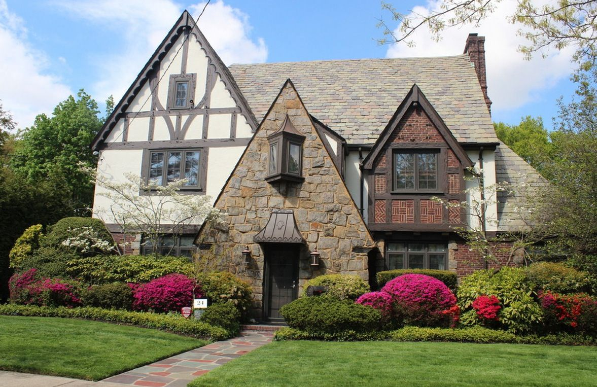 Plant composition near Tudor style house with sharp-edged structure