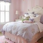 pink toned bedroom with a lot of textile and few vintage notes