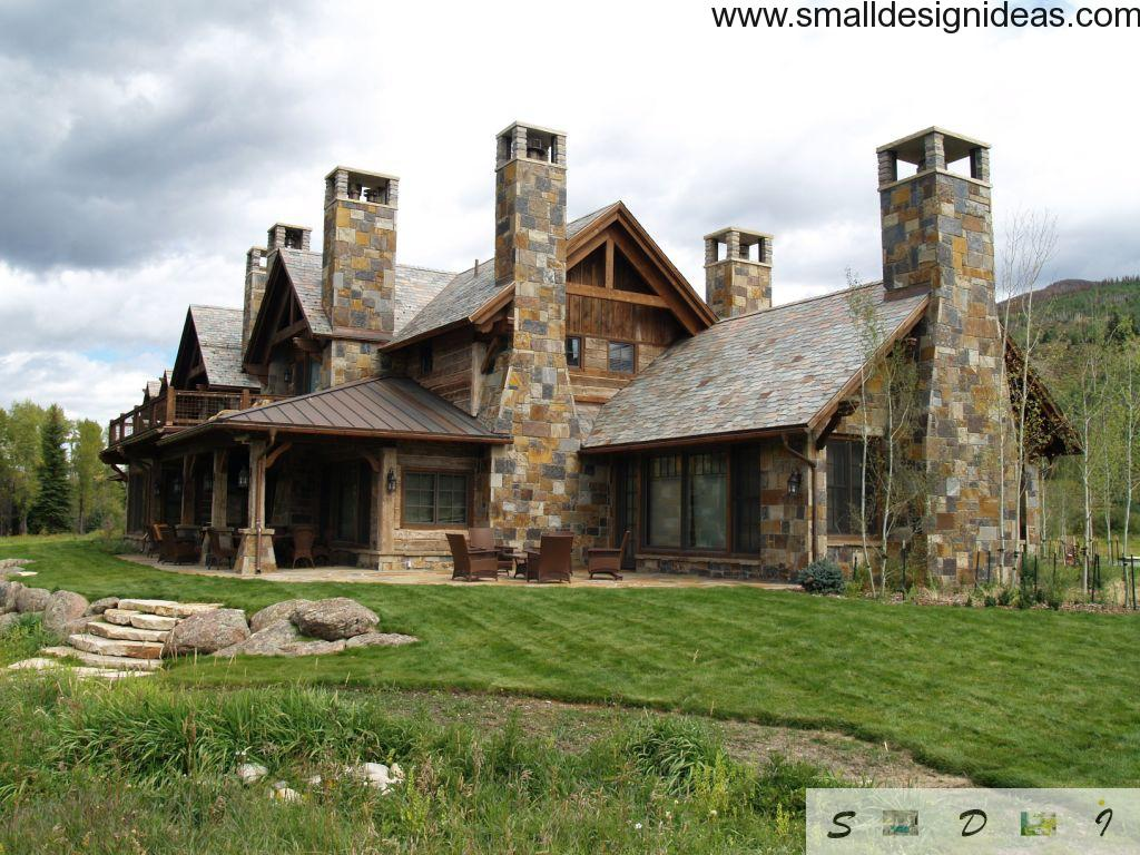 English Tudor style house of different color stones with nice backyard lawn for leisure