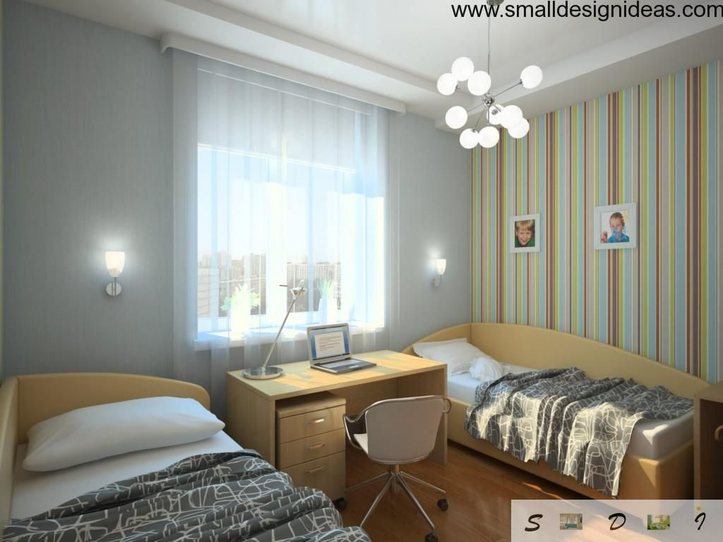 Two beds in a bedroom with a workplace