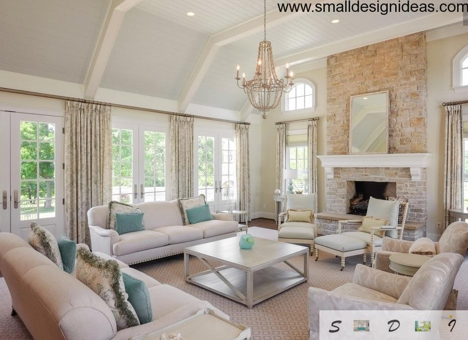 white creamy living with a big chandalier