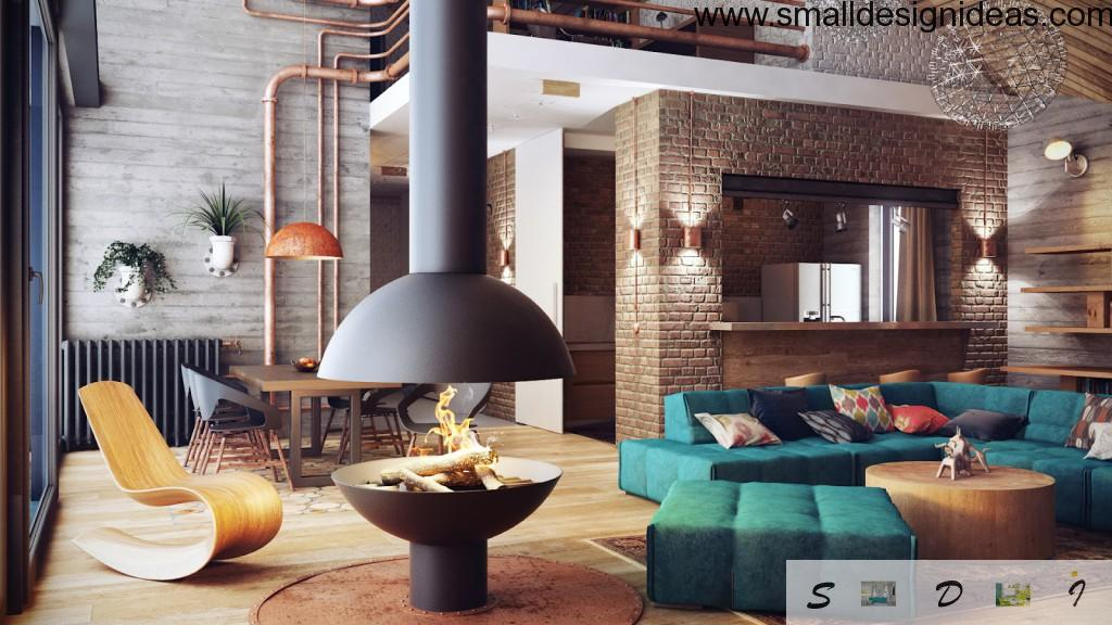 Loft interior of the living room with original safe fireplace and turquoise furniture