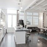 Redesigned apartment with a large Loft island kitchen in a sterile light colors