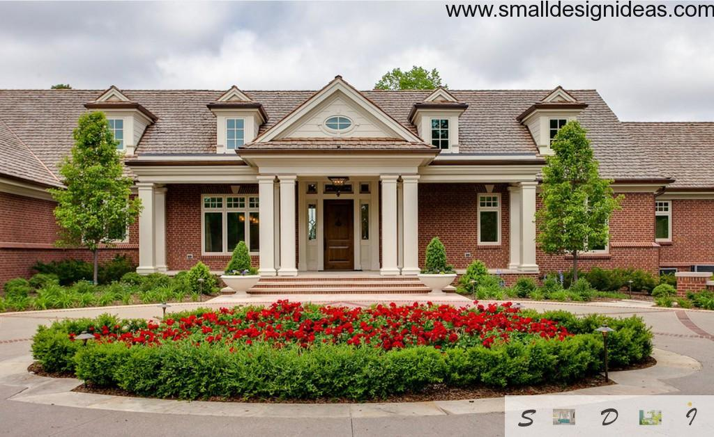 The thorough landscape design near the nice modern English style house with white columns and small windows