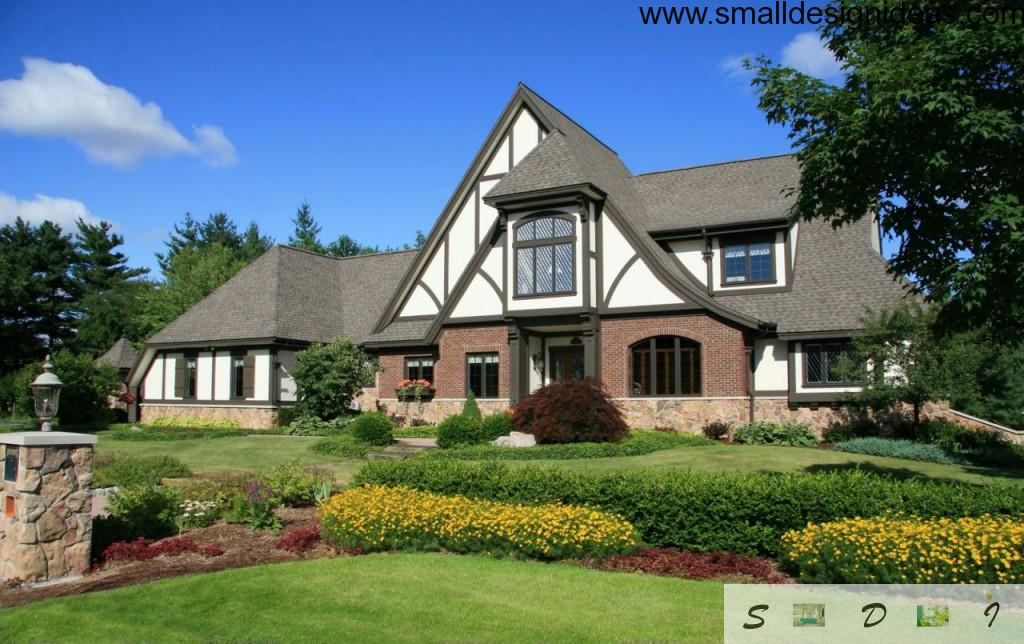 Nice Tudor style house with house adjoining flower beds, rigor design and wide windows