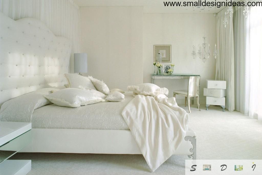 White creamy houes in the small bedroom interior